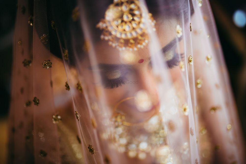 Photo of Bride under veil shot