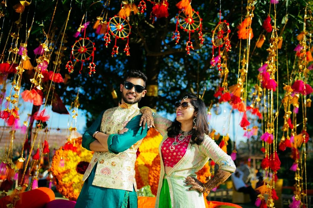 Photo of Bright and colorful mehendi decor elements