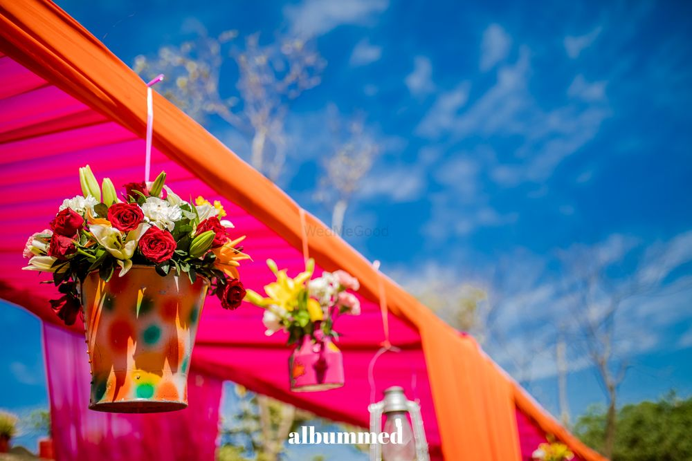 Photo of Hanging floral arrangement setting in buckets