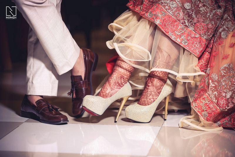 Photo of Couple shoe shots wedding day