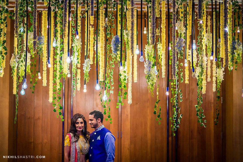 Photo of Lighting idea with floral strings hanging for engagement decor