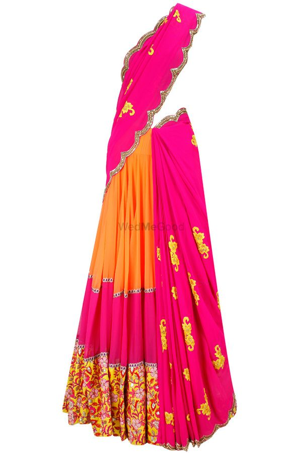 Photo of Bright pink and orange lehenga with yellow embroidery