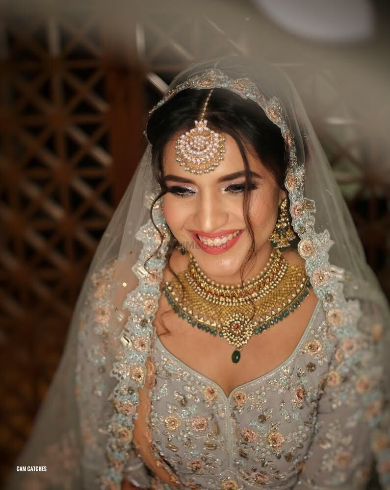 Photo of Offbeat bride in grey lehenga
