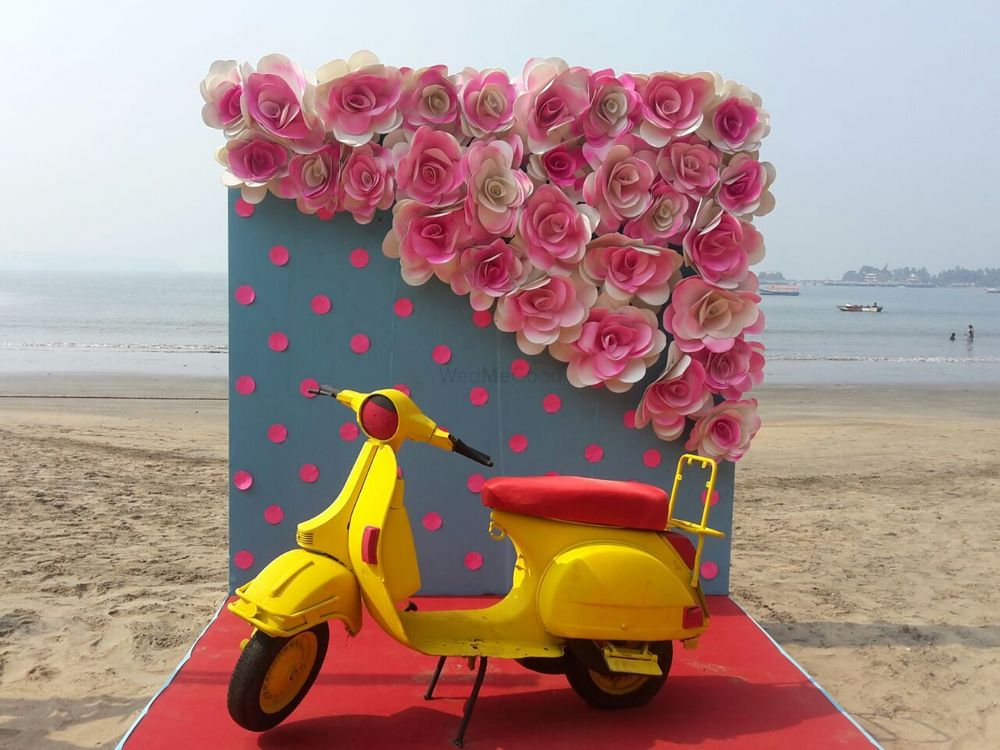 Photo of Beach wedding photobooth with scooter