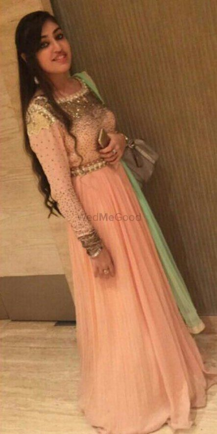 Photo of shimmery peachy pink floor length gown with mint green dupatta