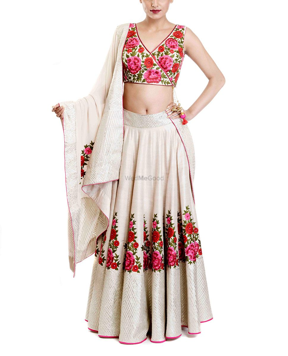 Photo of floral print blouse with plain white skirt and floral resham work embroidery