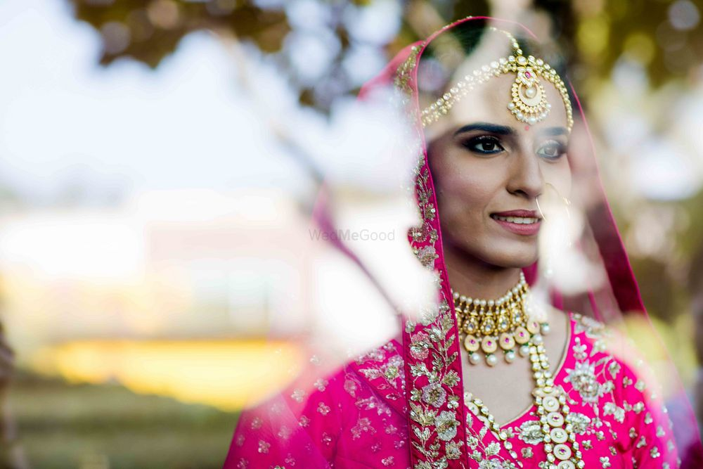 Photo of Candid bridal portrait behind the mirror