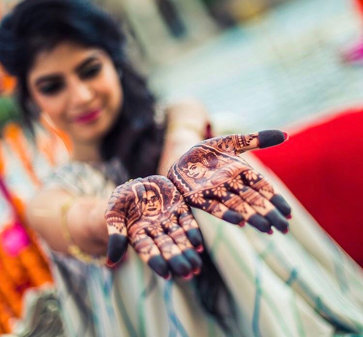 Photo of Bridal mehendi with portraits on display