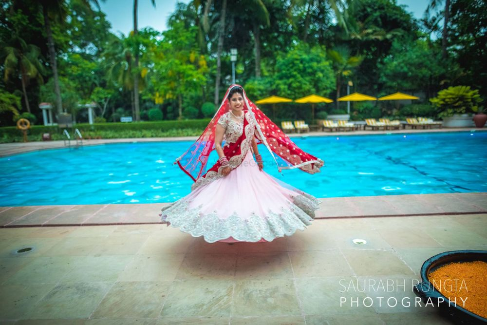 Photo of Baby Pink and Red Twirling Lehenga