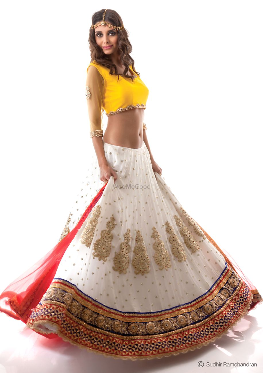 Photo of Light white lehenga with yellow sleeveless blouse