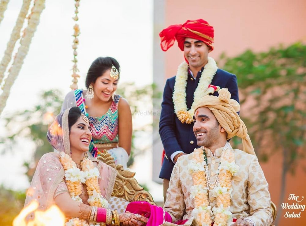 Photo of cute and happy couple shot during the jaimala