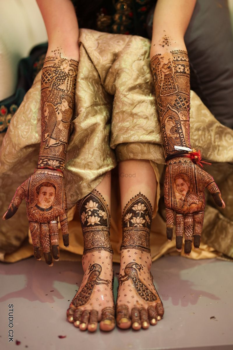 Photo of Bridal mehendi design for hands and feet with portraits and peacock motif