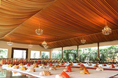 Photo of Orange Tent with Mini Chandeliers Decor