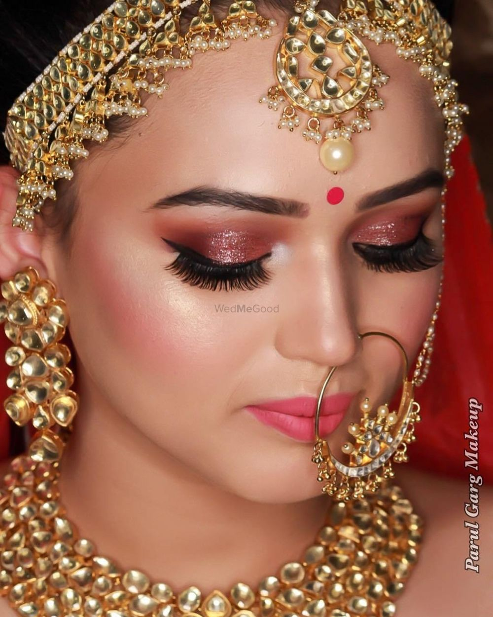 Photo of Beautiful dewy skin makeup with extended eyelashes and peach gold shimmer eyes with a lovely highlight