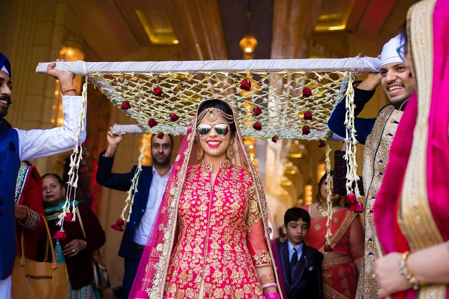 Photo of Cool bride under chadar wearing glasses