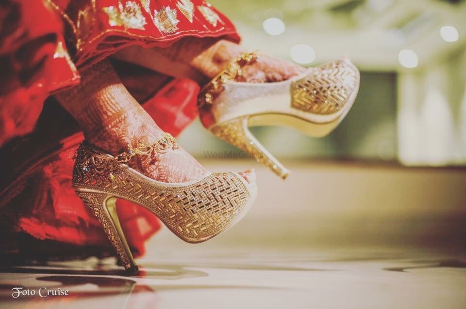 Photo of Gold bridal heels with design