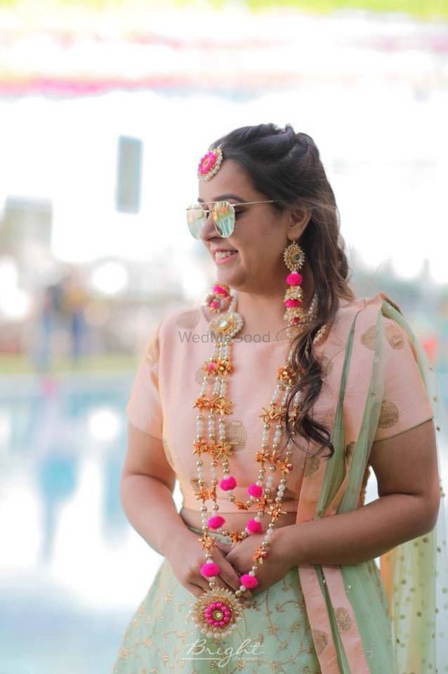 Photo of Bride in gota and pompom jewellery with satlada