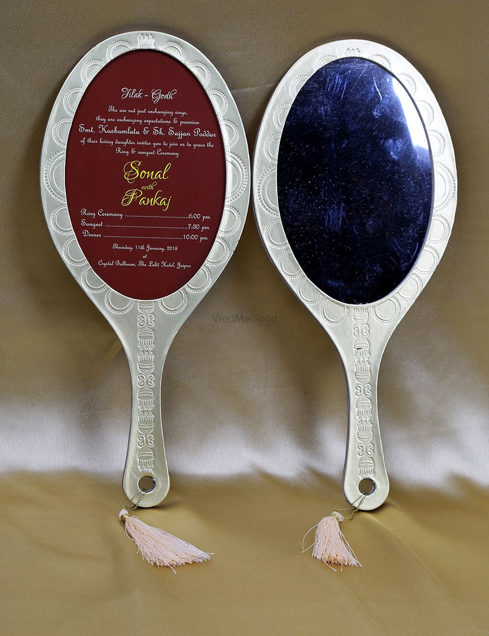 Photo of Wedding card shaped like hand mirror
