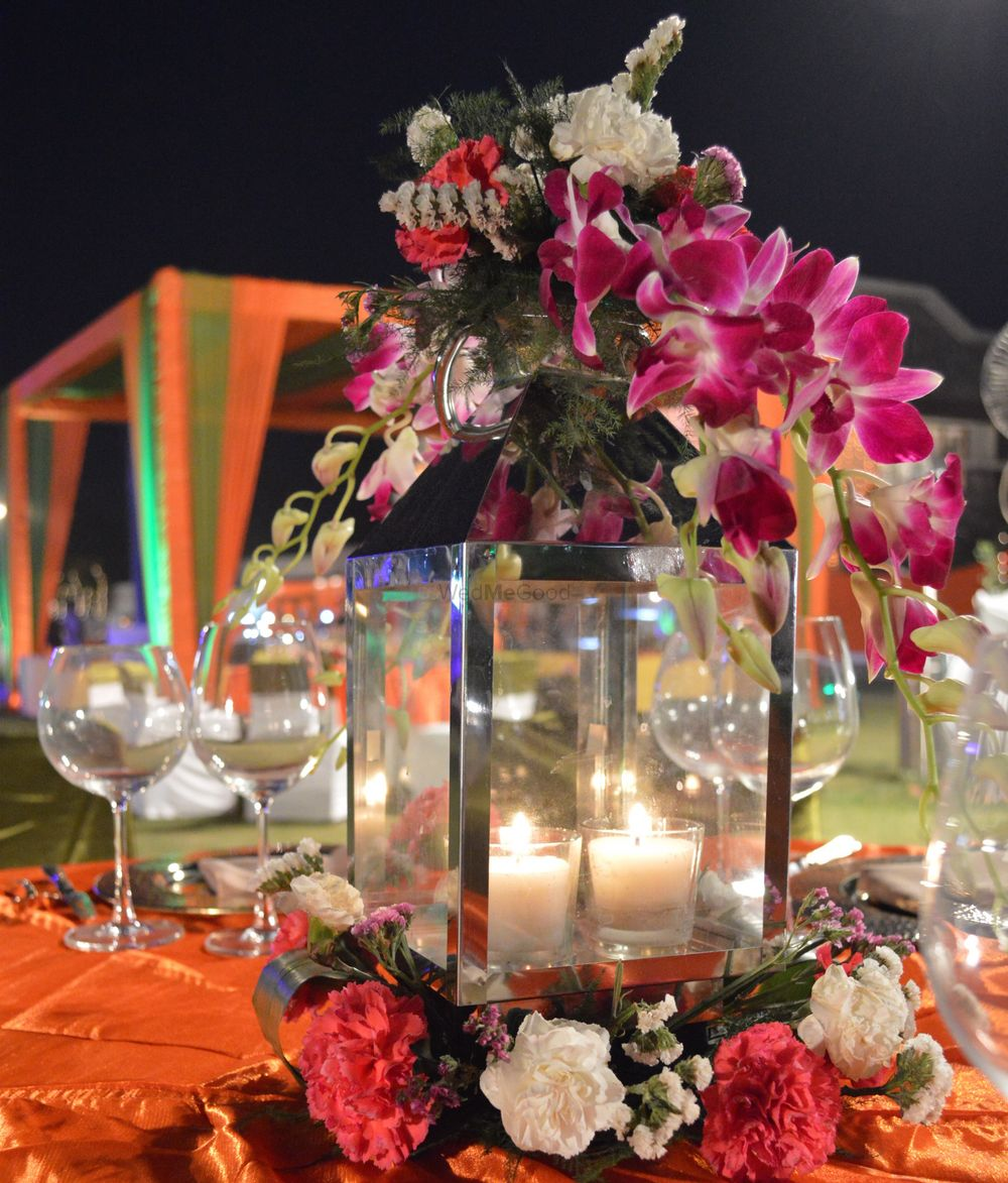 Photo of Floral and candle lit table setting