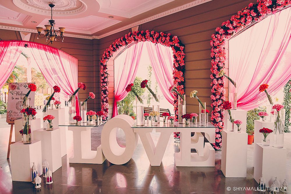 Photo of Pretty LOVE decor with pink flowers