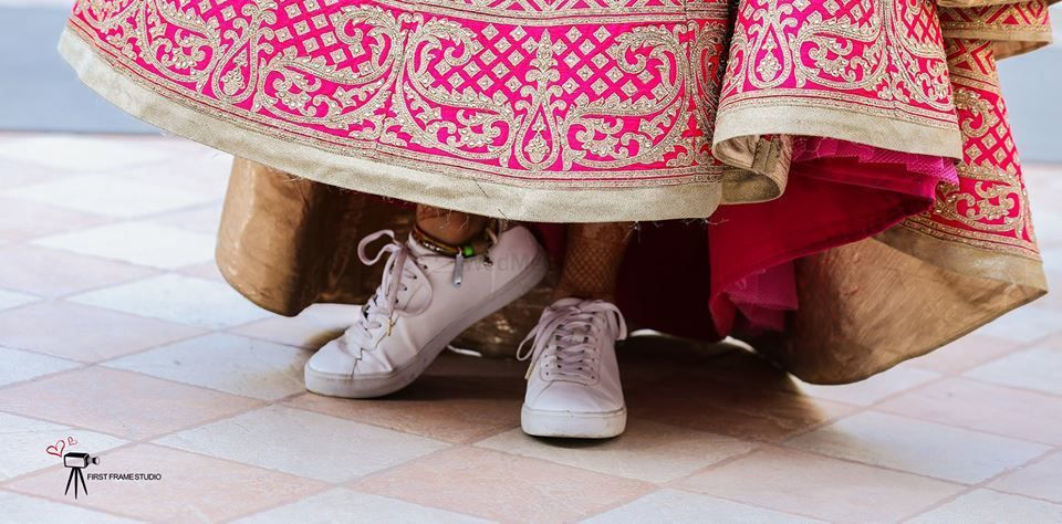 Photo of Bride wearing sneakers bridal shoes