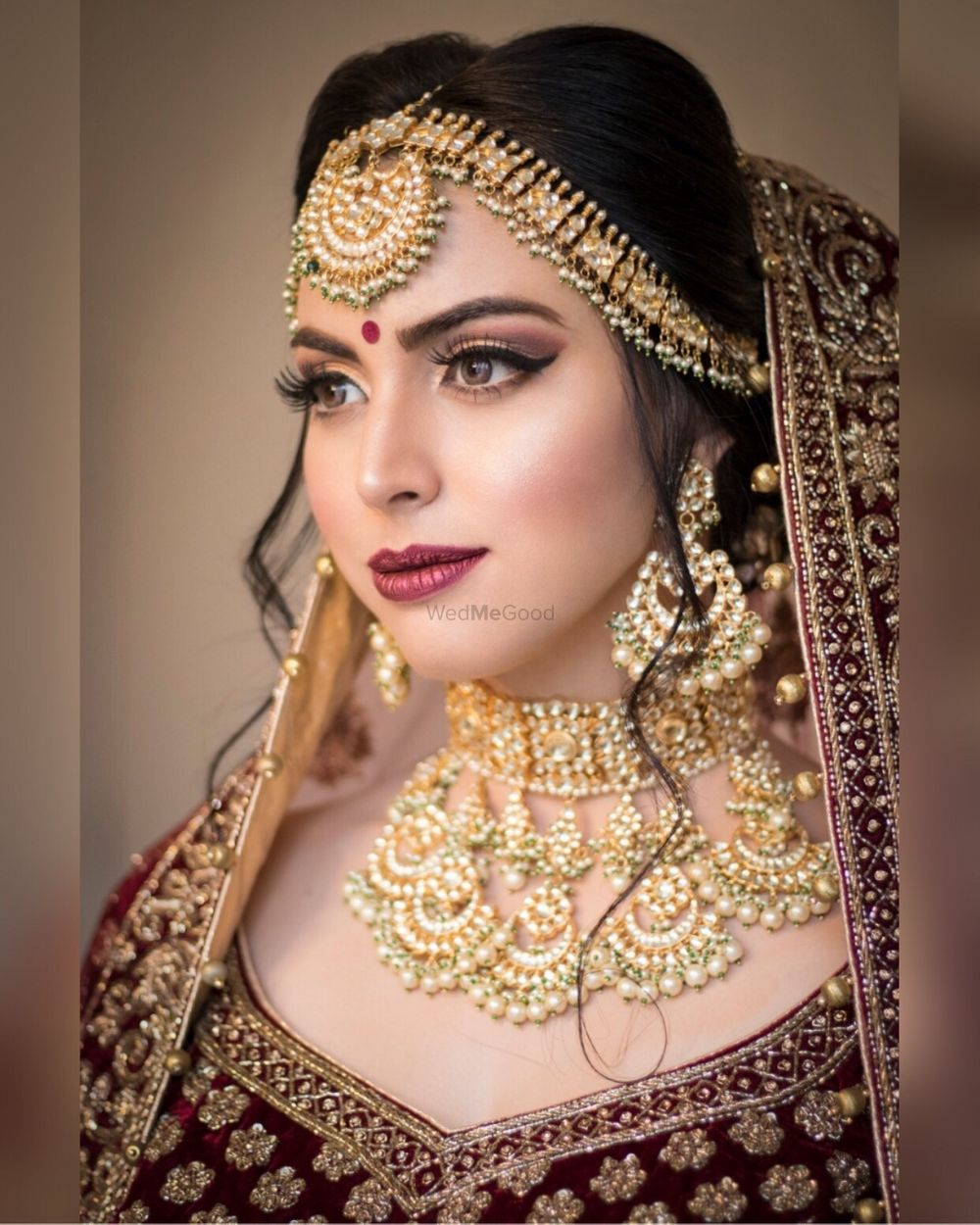 Photo of A close up shot of a bride wearing nude makeup