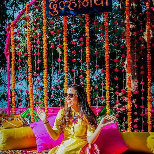 Photo of Mehendi bridal seat with happy bride