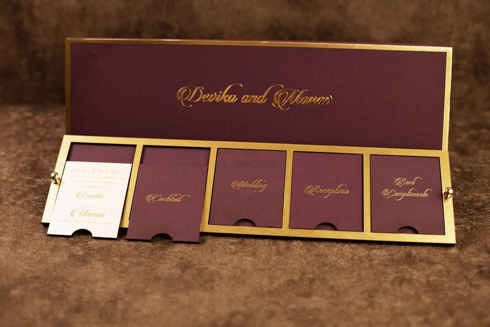 Photo of wine and gold invitation
