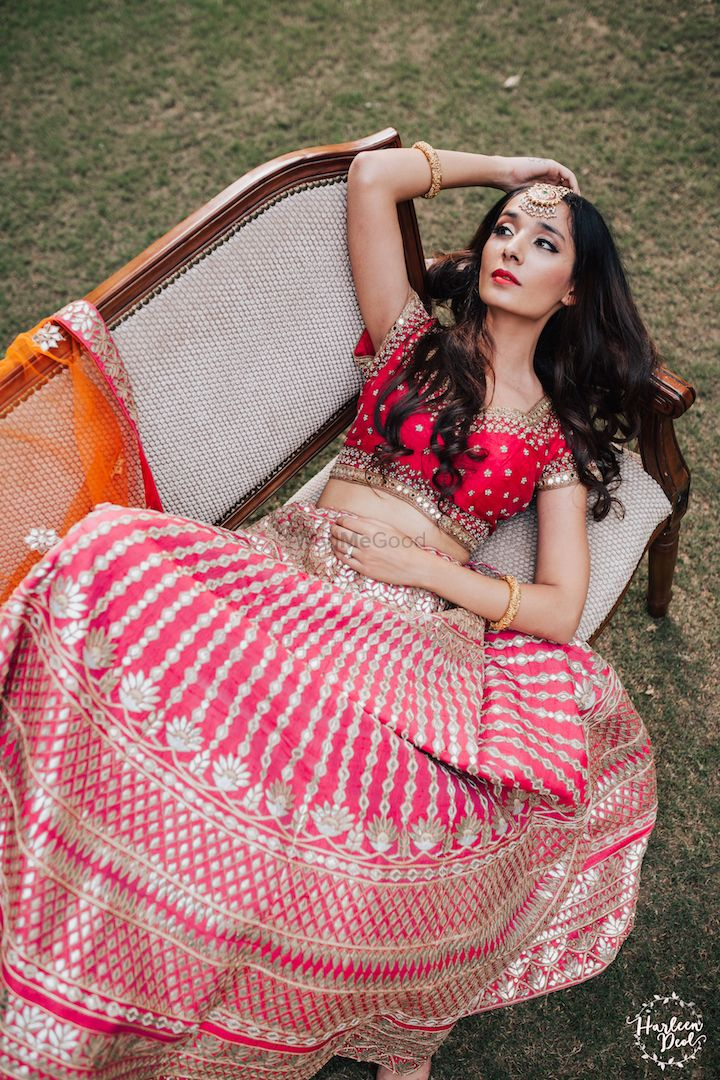 Photo of Bride posing in pink gota patti lehenga