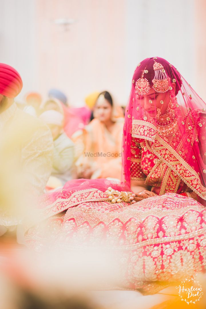 Photo of Sikh bride with veil in red lehenga