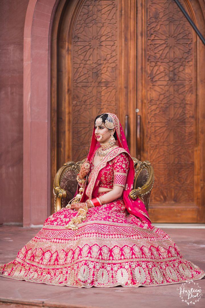 Photo of Regal bridal portrait pose in red lehenga