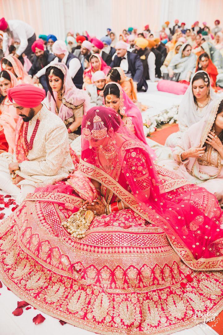 Photo of Red Sabyasachi bridal lehenga flared out