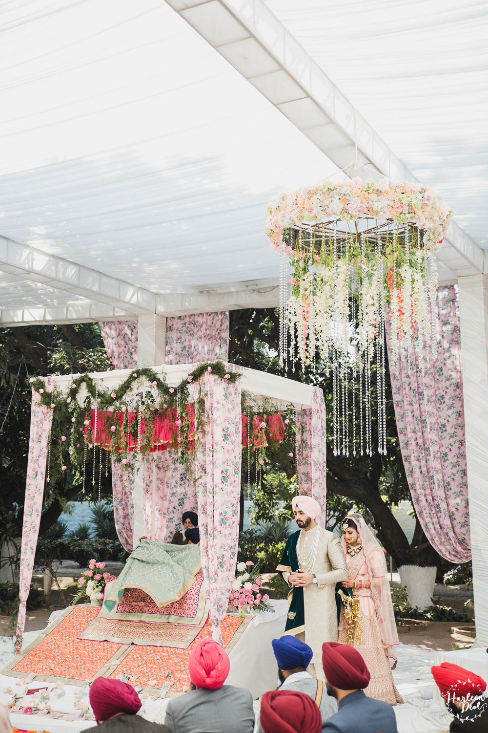 Photo of Mandap with floral drapes