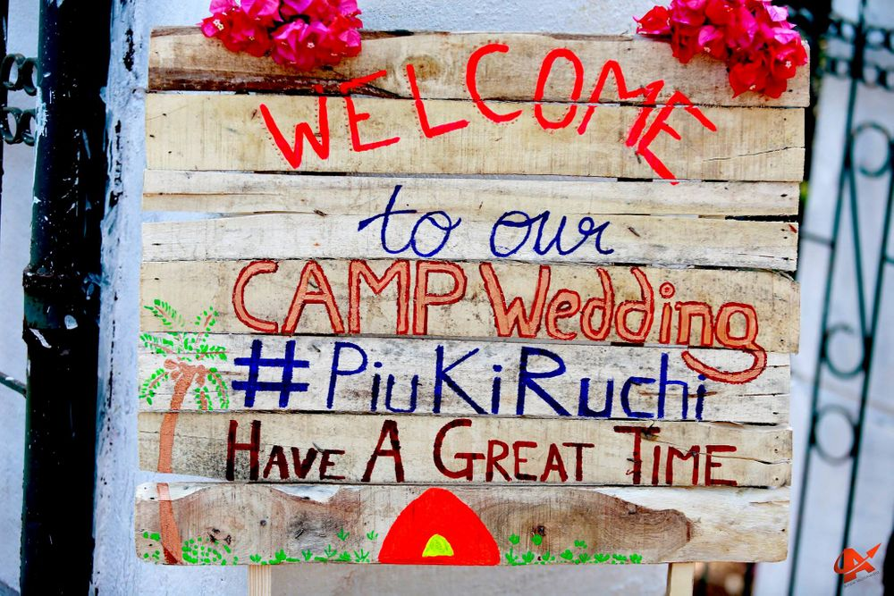 Photo of DIY welcome sign for camp wedding