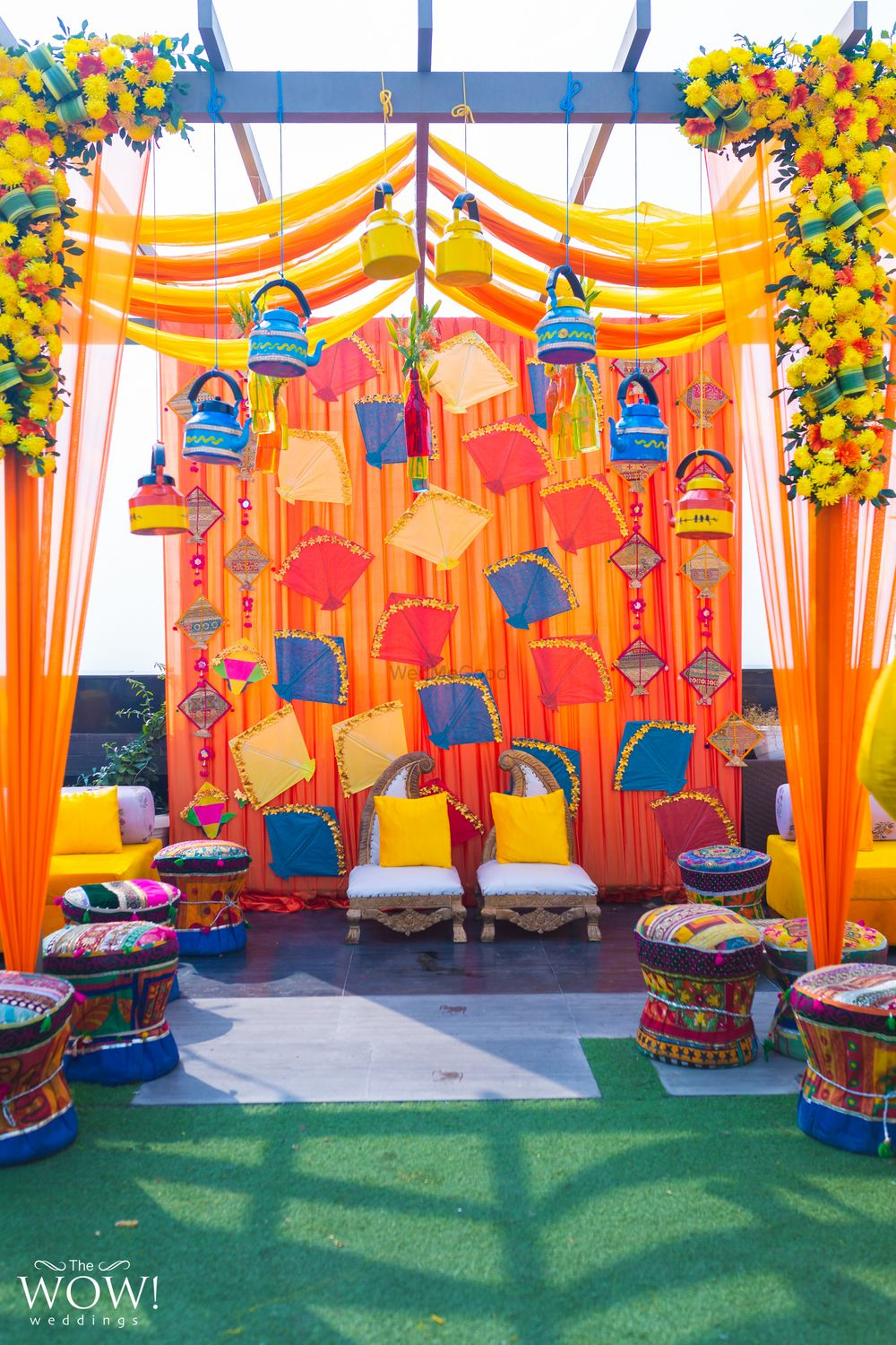Photo of Colourful mehndi decor idea with kites in photobooth