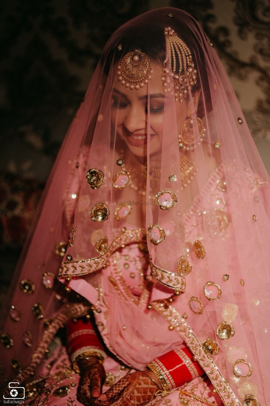 Photo of Beautiful bridal portrait with pink and gold lehenga for wedding