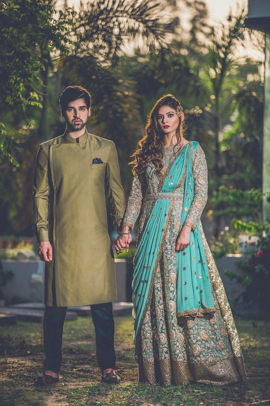Photo of Unique bride and groom outfit for engagement