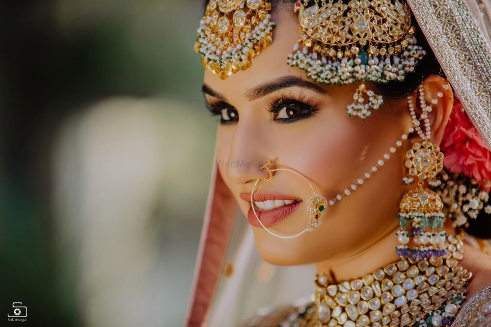 Photo of Oversized bridal jewellery with Nath and jhoomer