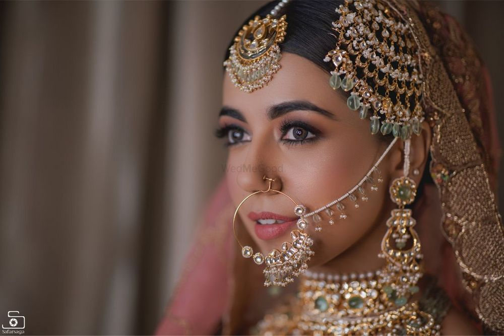 Photo of Shot of a bride wearing gorgeous statement jewellery at her wedding