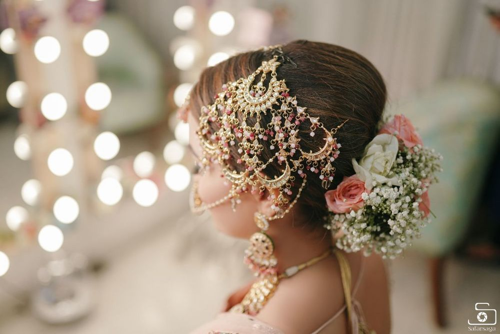 Photo of oversized bridal jhoomer with light pink stones