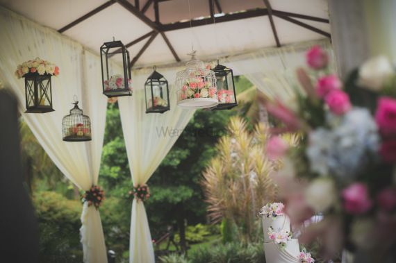 Photo of Hanging lamps with florals in day decor