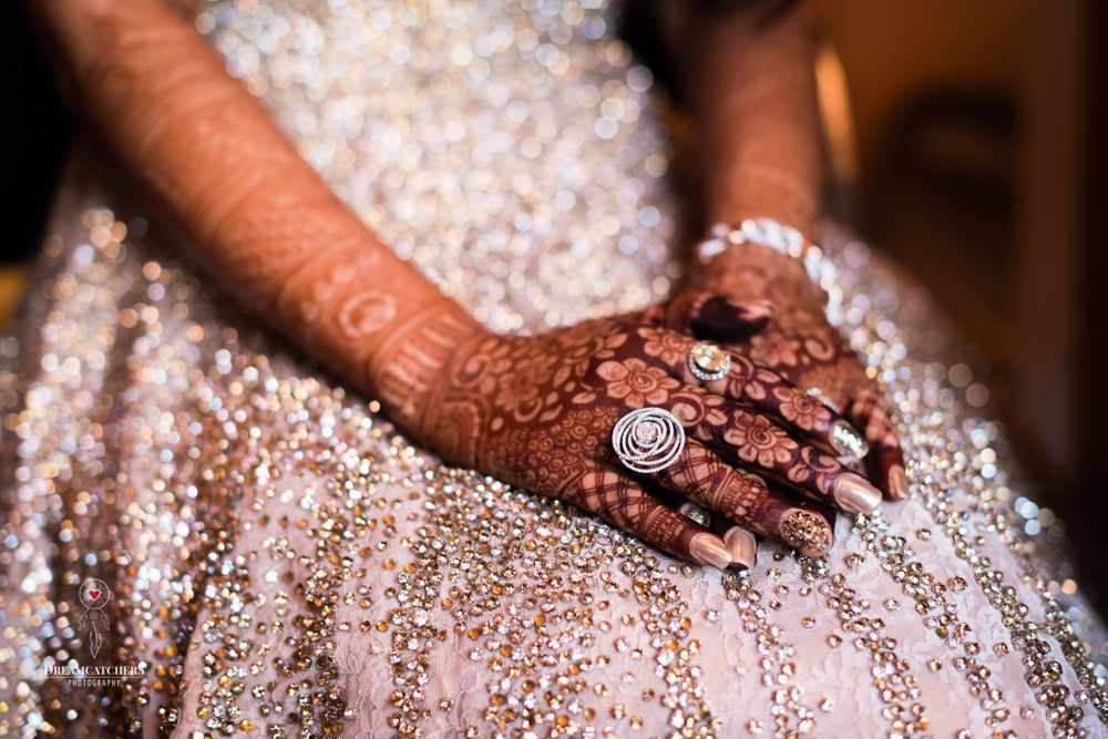 Photo of Bridal hands with mehendi and cocktail ring