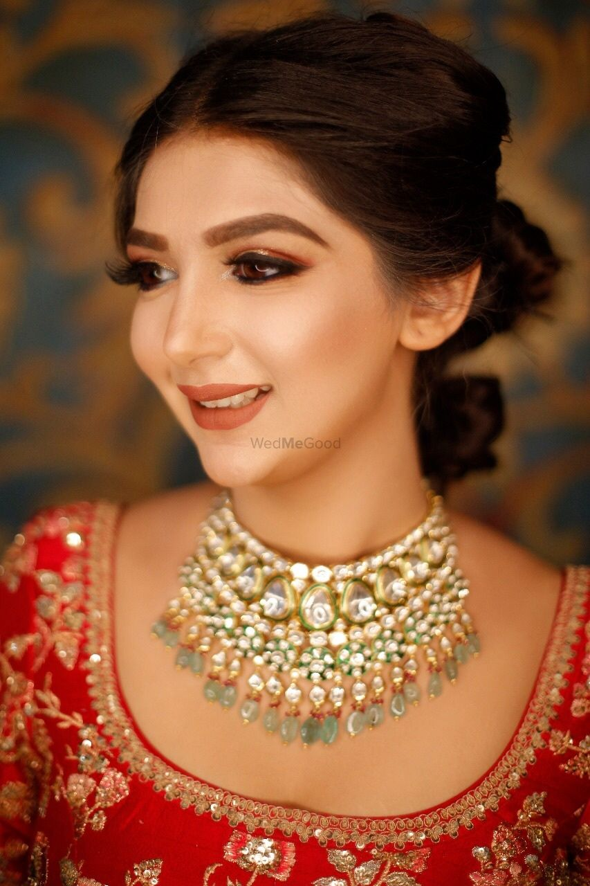Photo of A bride in red with subtle makeup