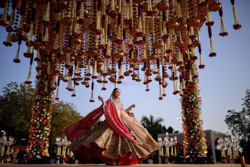 Photo of Bride twirling around under her mandap.