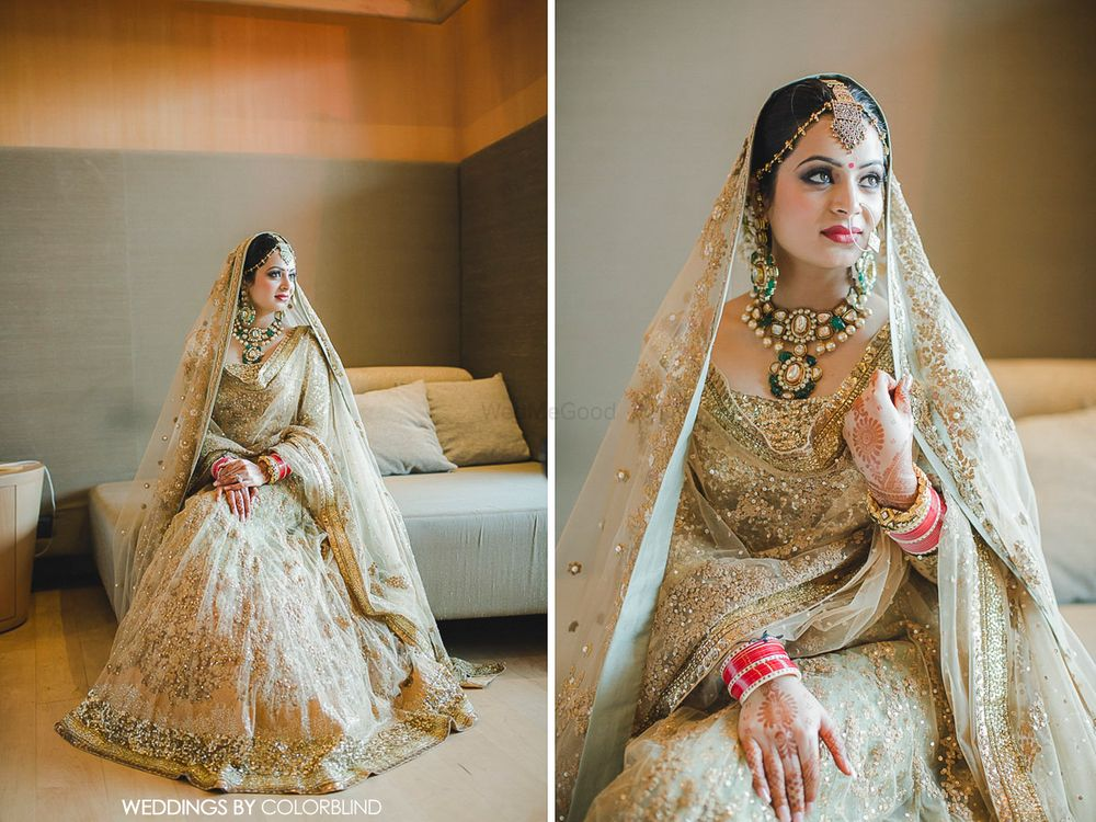 Photo of goldlehenga with atouch of green