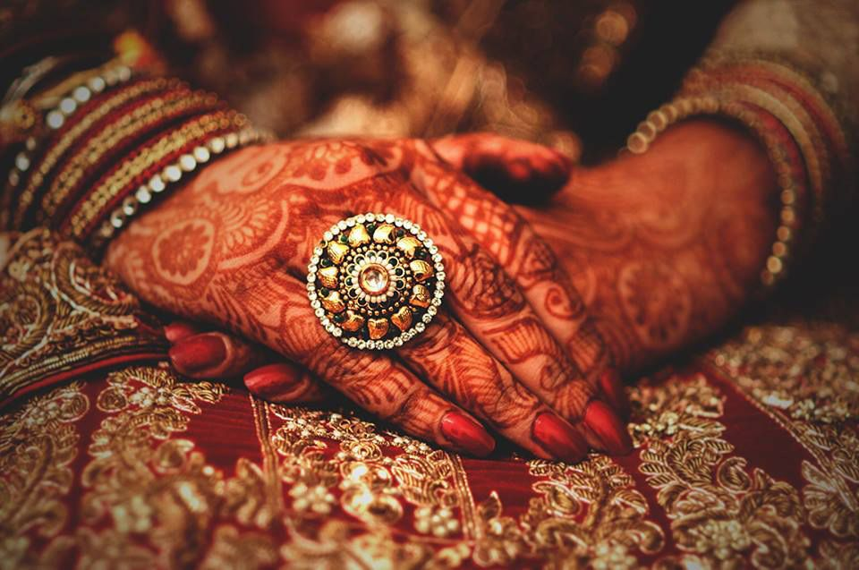 Photo of Bridal hands with round cocktail ring