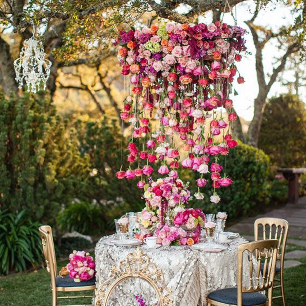 Photo of Pretty table setting with cascading floral chandelier
