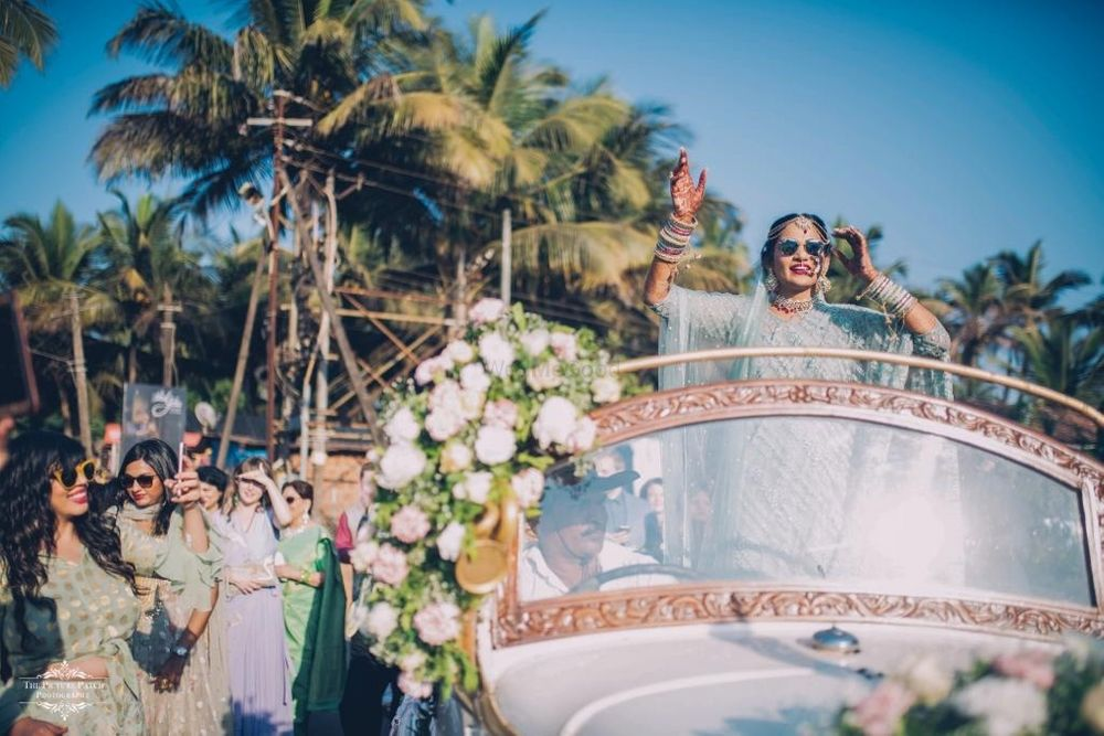 Photo of Bridal entry in vintage car with open top