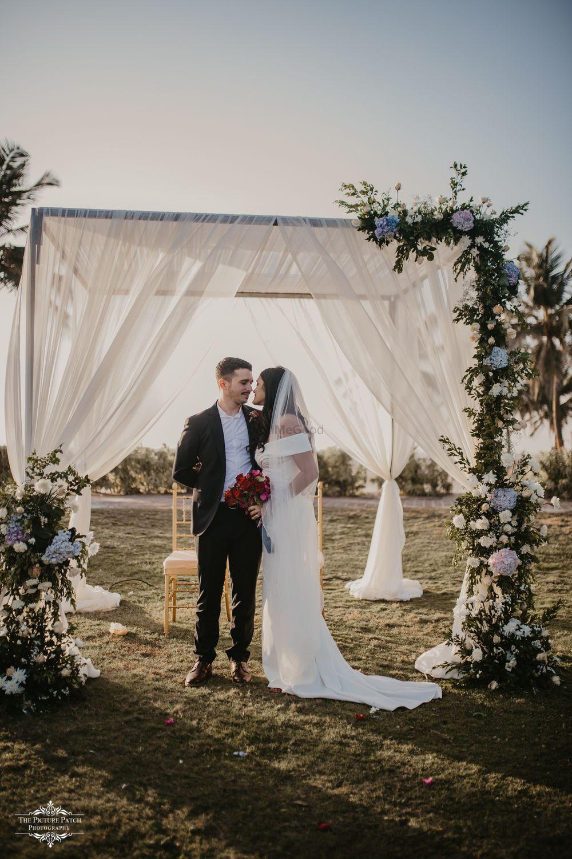 Photo of Christian wedding decor and couple shot