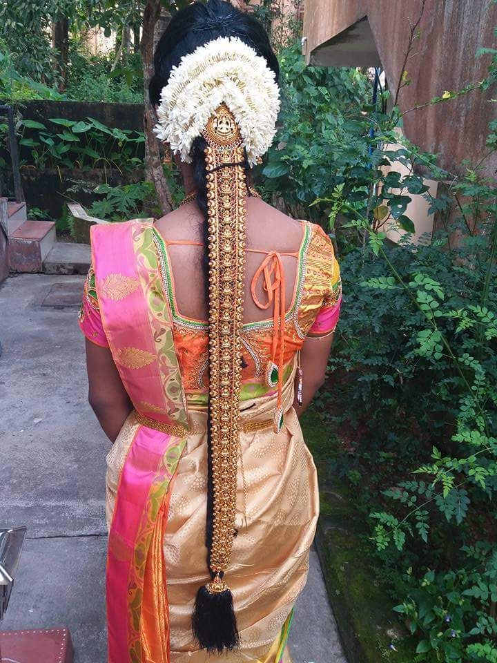 Photo of Unique south Indian floral jada with gold hair ornament